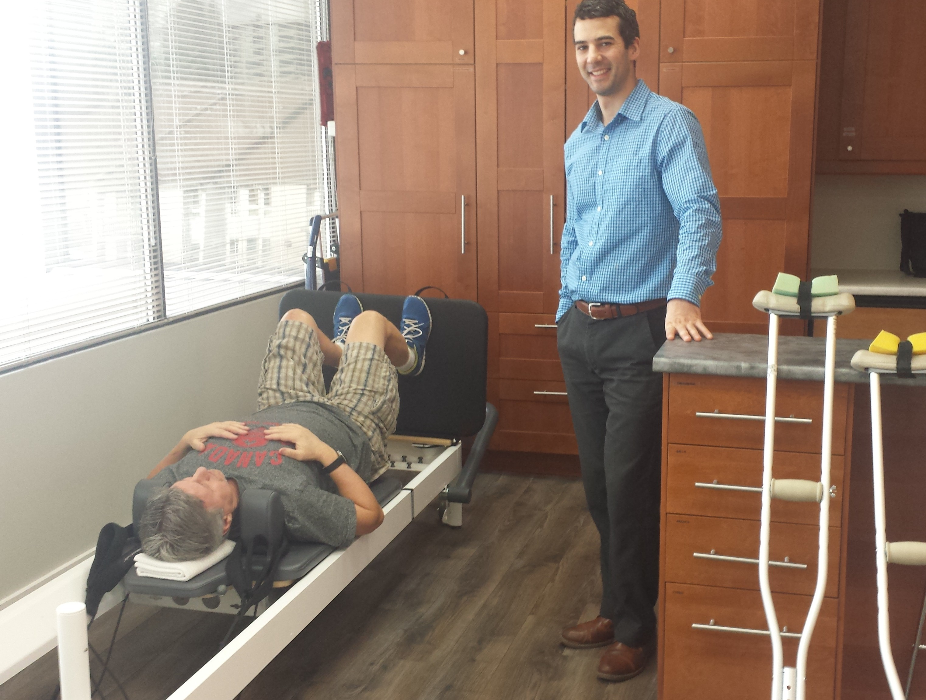 Jamie in clinic with patient on reformer Feb 2016